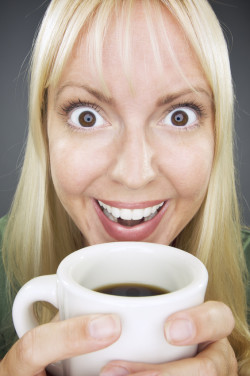 Beautiful Woman Enjoys Coffee